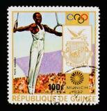 Vapensköld med ghymnast, olympiska spel i Munich, circa 1972 Arkivfoton