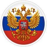 Vapenskölden som är från den ryska federationen mot bakgrunden av flaggan i form av en rund klistermärke arkivfoto