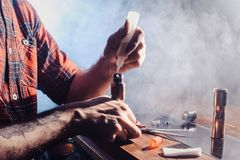 The process of servicing the mechanical vape device. Master replace wire for smoking. Ecig rapairing process. Vaper device repair service. Ecig rapairing royalty free stock photos