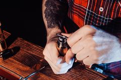 The process of servicing the mechanical vape device. Master replace wire for smoking. Ecig rapairing process. Vaper device repair service. Master replace wire royalty free stock photography