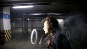 Vaper making stunts with steam rings