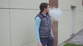 Vaper smoking electronic cigarette slow motion stock video footage