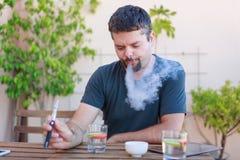 Vaping Adult Man, Smoking Electronic Cigarette Royalty Free Stock Images