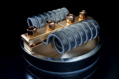 Vaping atomizer with clapton coil. 3d rendering. Vaping atomizer with clapton coil. Black background stock photo
