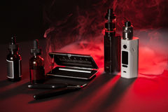 Vaping device mod on dark background. Repair,maintenance vaping device mod. Upgrade parts for modern vaporizer e-cig device,spare parts Stock Image
