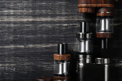 Vaping device. On the wooden table Stock Photo