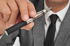 Vaping with an electronic cigarette Stock Photography
