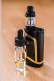 Vaping electronic mod and vape liquid. Royalty Free Stock Photos