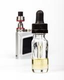Vaping electronic mod and vape liquid on white Royalty Free Stock Photos
