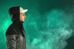 Vaping man and a cloud of vapor. Vaping man. A cloud of vapor. dark green background royalty free stock photo
