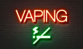 Vaping neon sign. On brick wall background Stock Images