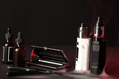 Vaping set on dark background. Repair,maintenance vaping device mod. Upgrade parts for modern vaporizer e-cig device,spare parts Stock Images