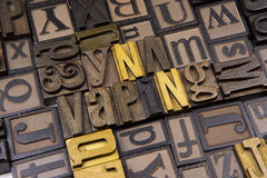 Vaping in wooden typeset. The word Vaping surrounded by random typeset Stock Photos