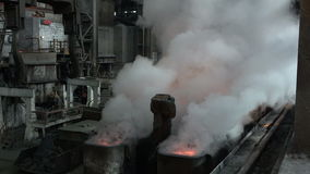 The vapor above the workpiece after the spill metal and extinguish it with water 4. Stages of the steel plant for the production of steel and iron stock footage