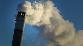Vapor from chimney. Thick vapor coming out of chimney at power plant stock footage