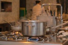 Vapor en el pote en cocina Fotos de archivo libres de regalías