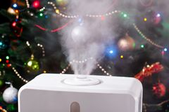 Vapor from humidifier on Christmas background. Humidification. Vapor Royalty Free Stock Photography