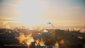 Vapor and river industrial cranes, winter frozen cold at sunset, time-lapse stock video footage