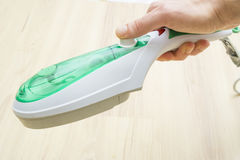 Vapor steam cleaner. Handheld vapor steam cleaner kills bacteria stock images