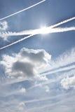 Vapor trail. Sky over frankfurt with sun behind vapor trail Stock Images