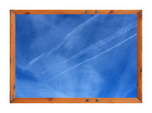 Vapor trails in blue sky Royalty Free Stock Photography