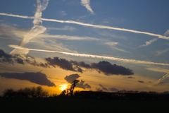 Vapor trails and sunset. Vapour trails from aircraft on a spring evening over South Wales, UK stock images