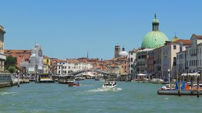 Vaporetto and motorboats moving down Grand Canal in Venice, transportation. Stock footage stock footage