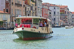Vaporetto with passengers in Grand Canal. Venice, Italy Royalty Free Stock Photography