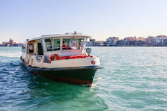 Vaporetto. The typical bus boat called Vaporetto (ferry), navigating through Venice canals stock image
