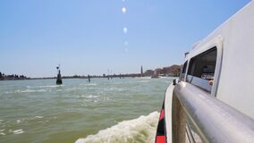 Vaporetto vessel moving along Grand Canal, tourists on sightseeing trip, Venice. Stock footage stock video footage