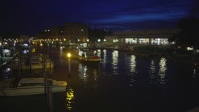 Vaporetto water taxi taking tourists to hotel at night, transport in Venice. Stock footage stock footage