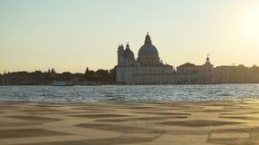 Vaporettos floating on Grand canal along Santa Maria della Salute church, Venice. Stock footage stock video footage