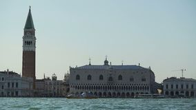 Vaporettos sailing near famous Doge's Palace in Venice, water tour, tourism. Stock footage stock footage