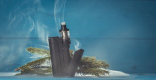 Vaporizer with fir branches. On blue background in smoke Royalty Free Stock Photography