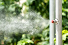 Vaporizer on a garden irrigation pipe Stock Image