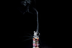 Vaporizer tank with small cloud of steam. RDA Mage coilart tank vaporising glycerine liquid Stock Photography