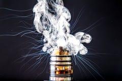 Vaporizer vape cloud explosion. Vaporizer smoke explosion on isolated black background in studio stock image