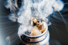 Vaporizers vape cloud - close up. Explosion vaping. Black isolated background in studio Royalty Free Stock Photography
