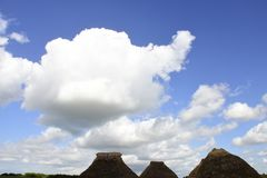 Vaporous white clouds. Fluffy white clouds against this blue sky over a rural area of Southern England Stock Images