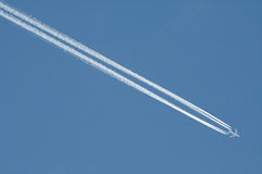 Vapour trail. An aircraft leaving a con trail Stock Photos