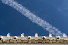 A Vapour Trail Above Ancient Roof Detail Stock Photography