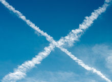 Vapour trails. From aircraft forming an cross Stock Image
