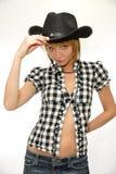 Vaqueira nova com o chapéu de vaqueiro preto imagem de stock royalty free