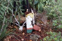 Vaqueiro Boot e crânio na cama de flor Fotos de Stock Royalty Free