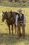 Vaqueiro com cavalo foto de stock