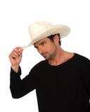 Vaqueiro em um chapéu branco e em uma camisa preta imagens de stock royalty free