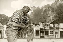 Vaqueiro preto no oeste velho Fotos de Stock