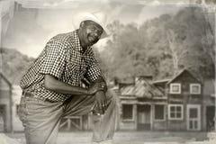 Vaqueiro preto no oeste velho Imagens de Stock Royalty Free