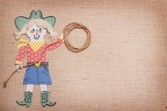 Vaquera en ropa occidental con el lazo del vaquero en manos corte del papel Fotografía de archivo libre de regalías