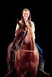 Vaquera joven con su caballo Imágenes de archivo libres de regalías